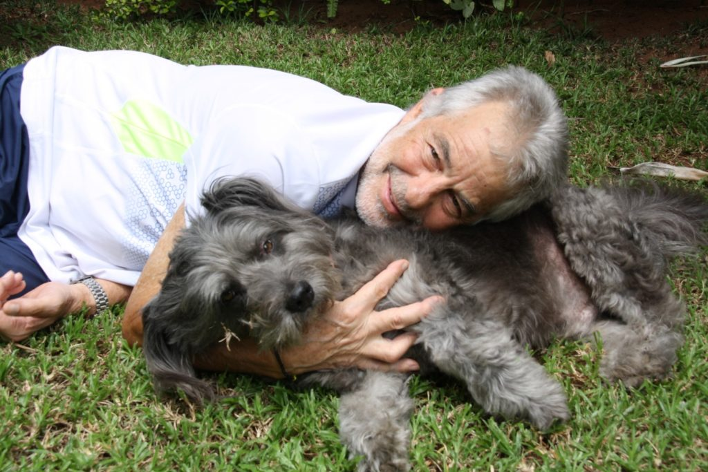 Humphery the SPCA mascot dog gets a love from his owner